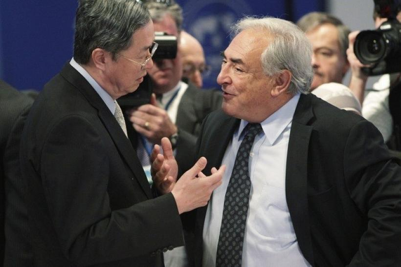 International Monetary Fund (IMF) Managing Director Dominique Strauss-Kahn (R) and Governor of People's Bank of China Zhou Xiaochuan seen in this file photo.