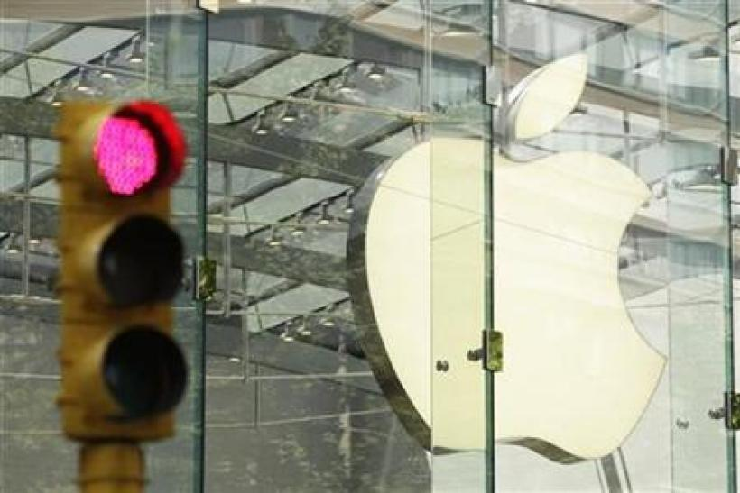 The Apple logo shines inside of an Apple Store in New York