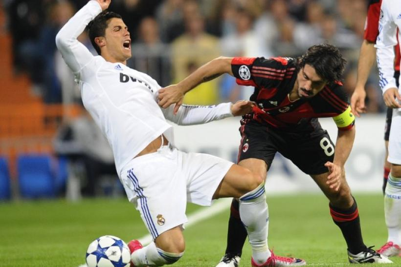 Real Madrid's Ronaldo is tackled by AC Milan's Gattuso during their Champions League Group G soccer match in Madrid.