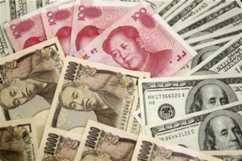 Japanese 10,000 yen notes, U.S. $100 notes, and Chinese 100 yuan notes in a picture illustration