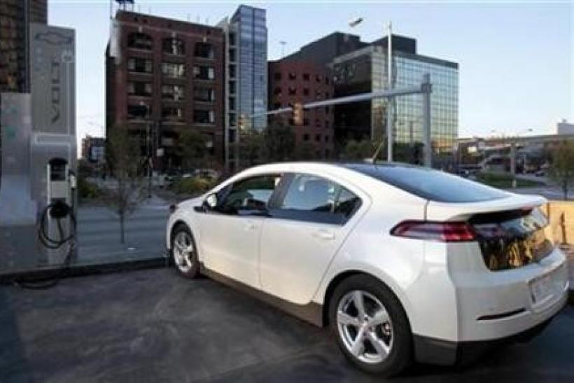 A Chevrolet Volt sits next to a newly installed electric vehicle charging station outside General Motor Co world headquarters in Detroit, Michigan October 12, 2010.
