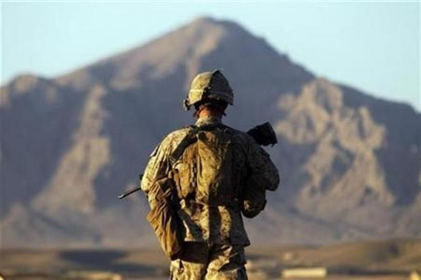A U.S. Marine from the First Battalion Eighth Marines Alpha Company patrols in the town of Nabuk