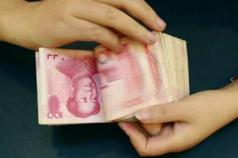 China launches lobbying push on currency bill