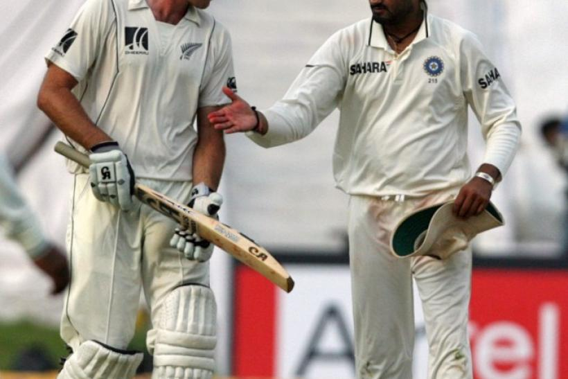 New Zealand's McIntosh is congratulated by India's Singh after he scored his century during during the first day of their second test cricket match in Hyderabad.