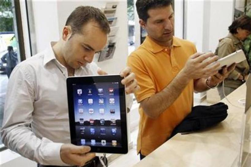 Visitors check out the new Apple iPads at an Apple retail store in Madrid