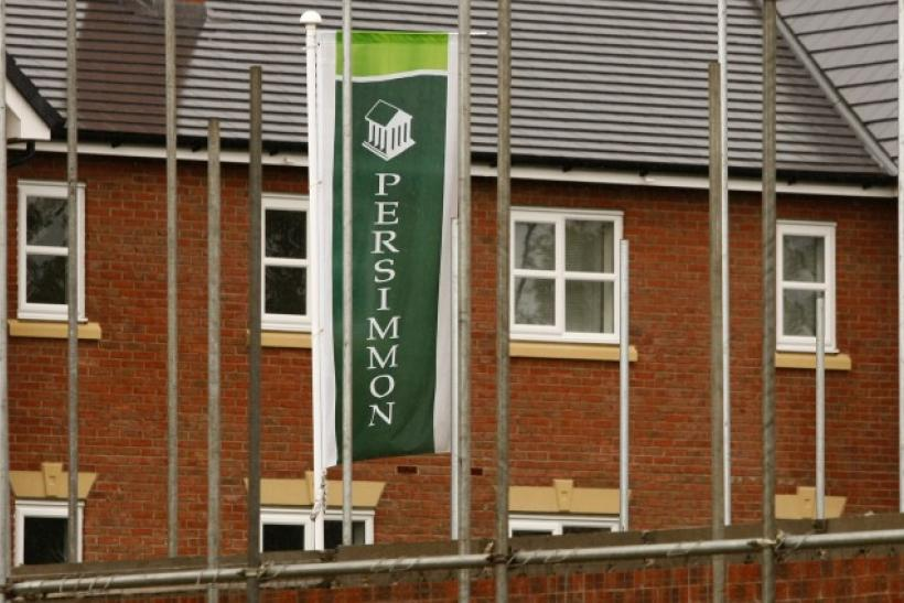 A Persimmon banner flies at a housing development near Manchester