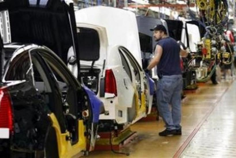 A General Motors assembly worker works on the production line for the 2011 Cadillac at the Grand River Assembly plant in Lansing, Michigan October 28, 2010.