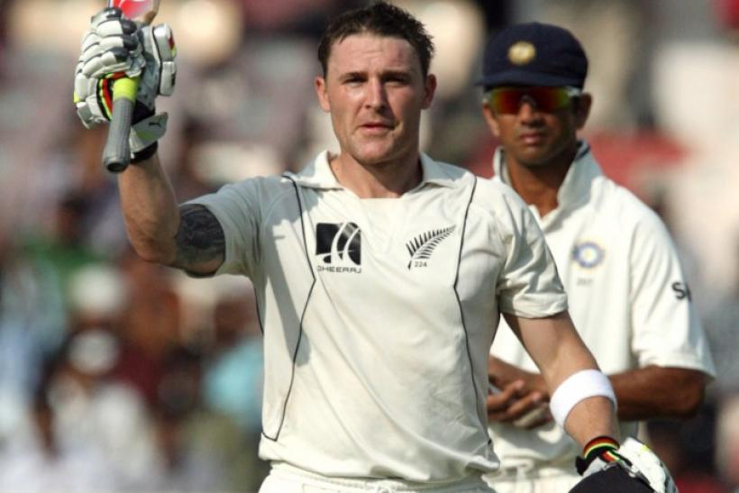 New Zealand's Brendon McCullum (L) celebrates after scoring a century on the fourth day of the second test cricket match in the southern Indian city of Hyderabad November 15, 2010.