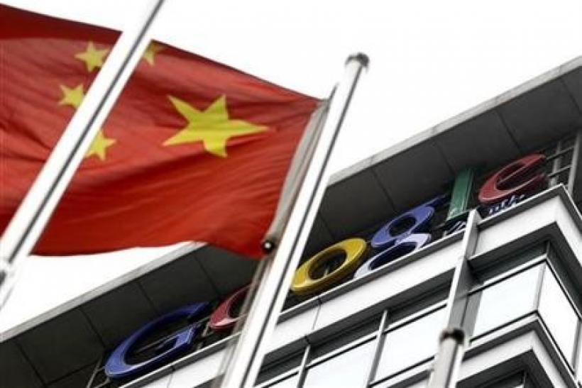 The national flag of China flies in front of the former headquarters of Google in Beijing - file photo