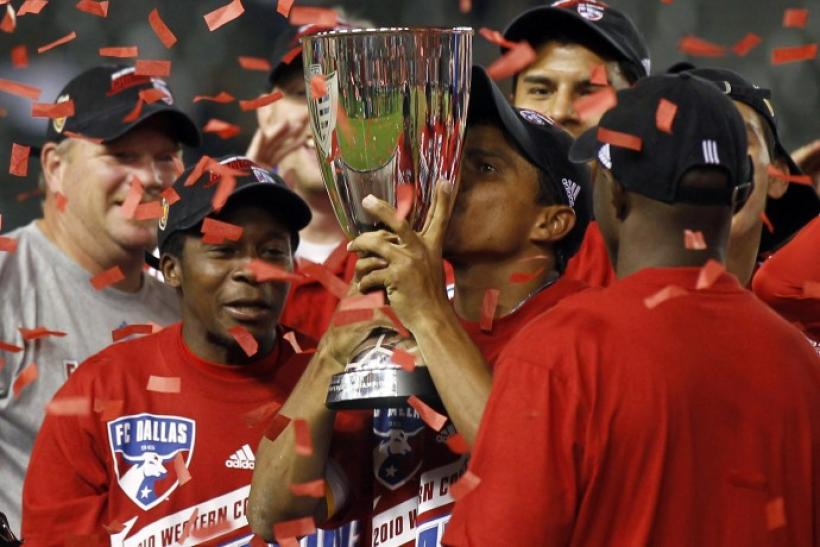 FC Dallas midfielder Ferreira kisses the trophy after they defeated Los Angeles Galaxy in their MLS Western Conference final match in Carson