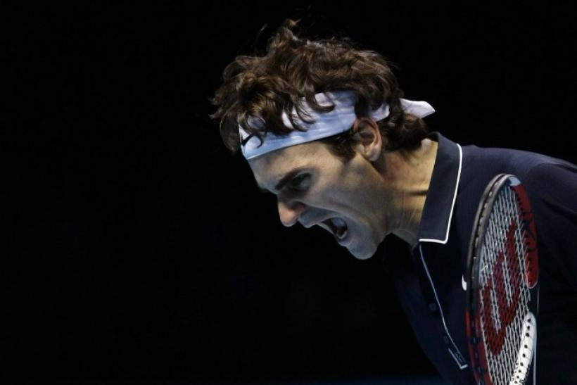 Roger Federer of Switzerland reacts during ATP World Tour Finals semi-final tennis match against Davydenko of Russia in London on 28/11/2009.