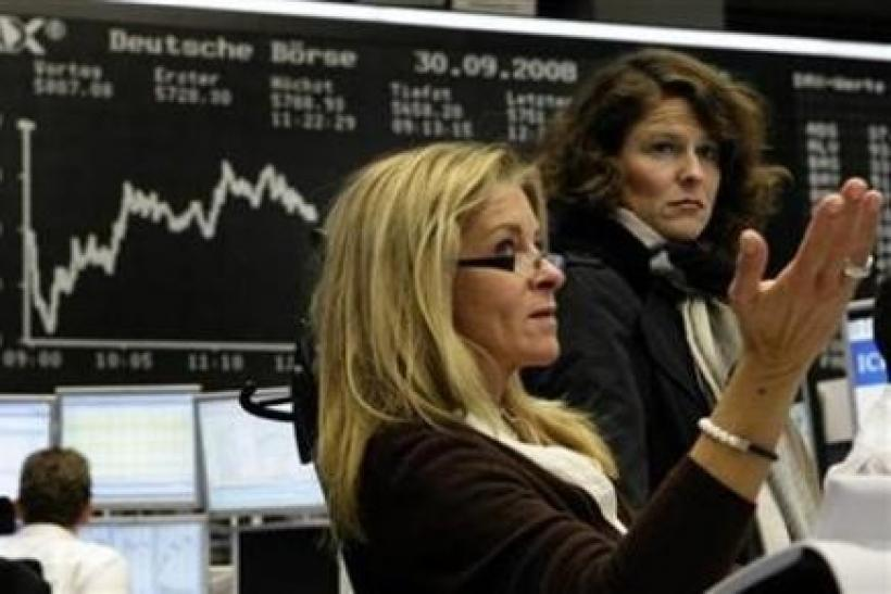 Traders react in front of the DAX board at the Frankfurt stock exchange September 30, 2008.