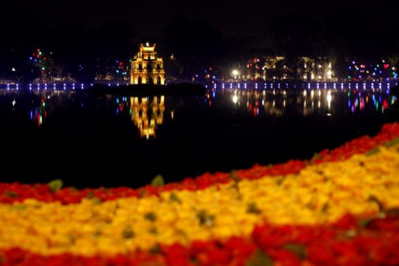 The Turtle tower is seen reflected on Hoan Kiem lake in Hanoi October 9, 2010 in Hanoi, Vietnam