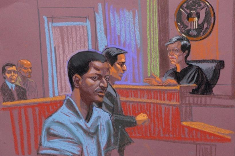 Ahmed Khalfan Ghailani, a Tanzanian held at the U.S. naval base in Cuba since 2006 accused of involvement in the bombing of U.S. embassies in Africa, is depicted in this courtroom sketch of his arraignment, in New York, June 9, 2009. Standing next to Ghai