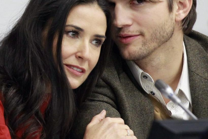 Actress Demi Moore and her husband actor Ashton Kutcher attend a news conference at the United Nations Headquarters in New York