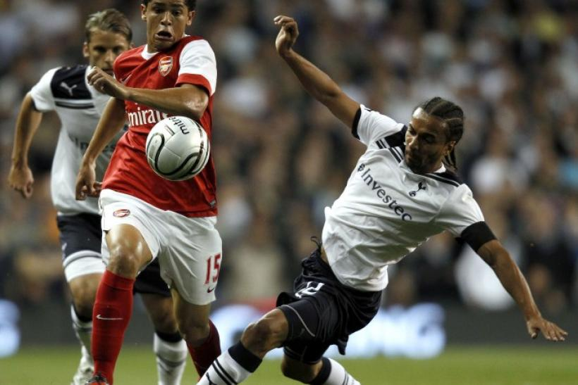 Tottenham Hotspur's Assou-Ekotto challenges Arsenal's Denilson during their English League Cup soccer match at White Hart Lane in London on 21/09/2010.
