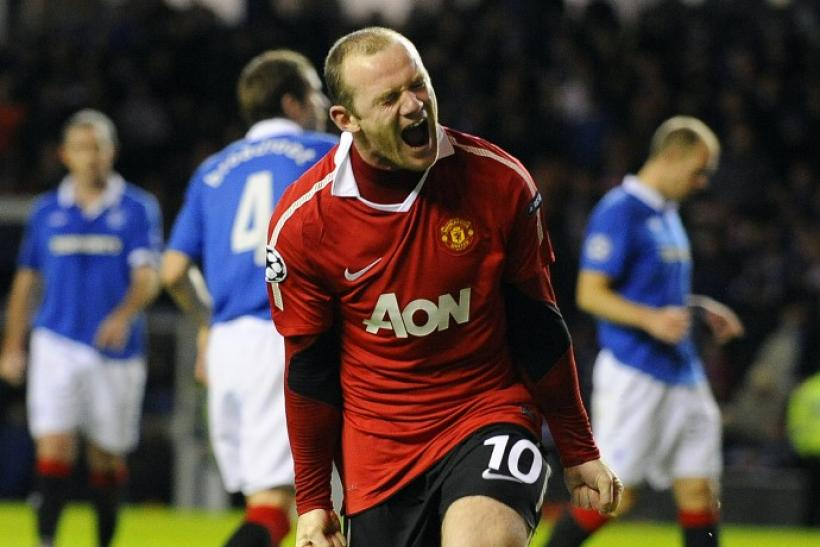 Manchester United's Rooney celebrates scoring a penalty kick during their Champions League soccer match against Rangers in Glasgow, Scotland.