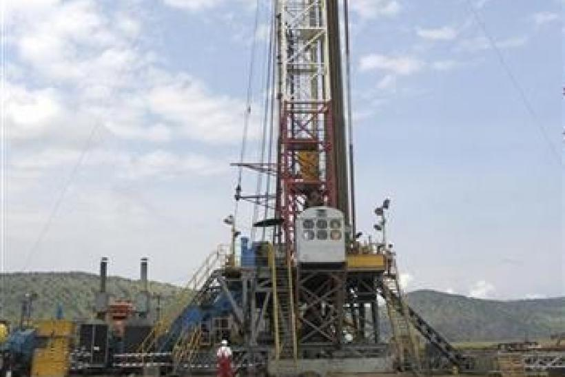 An oil rig prepares to drill in western Uganda, near the shores of Lake Albert