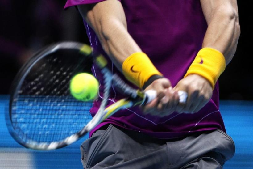 Spain's Nadal returns the ball to Serbia's Djokovic in their singles match at the ATP World Tour Finals in London.