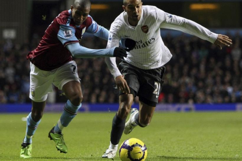 Arsenal's Clichy holds off Aston Villa's Young during their English Premier League soccer match in Birmingham.