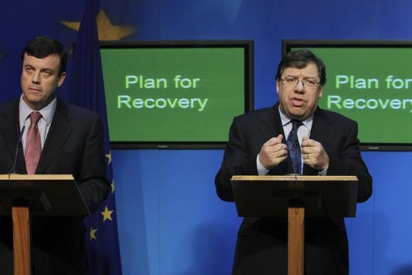 Ireland's Prime Minister Brian Cowen (R) speaks during a news conference, with Finance Minister Brian Lenihan, in Government Buildings, Dublin November 24, 2010.