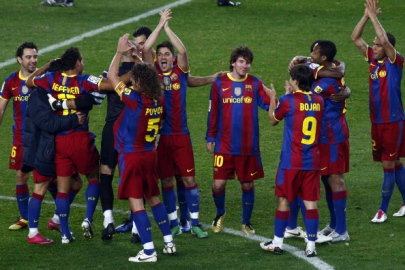 Barcelona's players celebrate victory over Real Madrid at the end of their Spanish first division soccer match in Barcelona.
