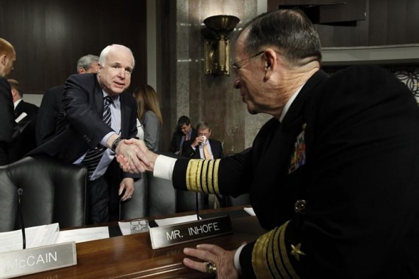 "U.S. Chairman of the Joint Chiefs of Staff Admiral Mike Mullen (R) shakes hands with Senator John McCain (R-AZ) before the Senate Arms Services Committee hearing about the ""Don't Ask, Don't Tell"" policy on gays serving in the military on Capitol"