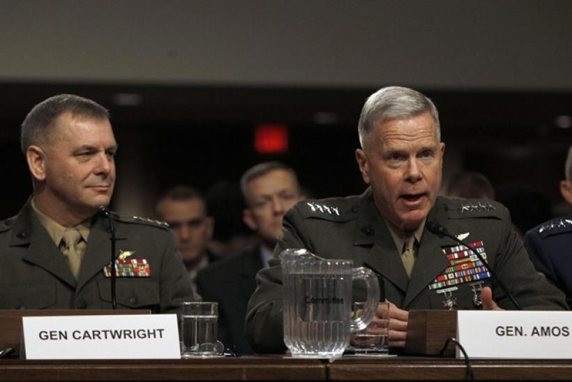 General James F. Amos, USMC, Commandant of the Marine Corps, testifies as General James E. Cartwright (L), USMC Vice Chairman of the Joint Chiefs of Staff, watches before the Senate Armed Services Committee hearing on a repeal of section 654 of title 10,
