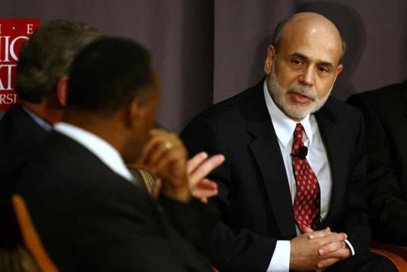 Federal Reserve Chairman Bernanke speaks with CEO of Moody Nolan Inc. Moody during a discussion at The Ohio State University