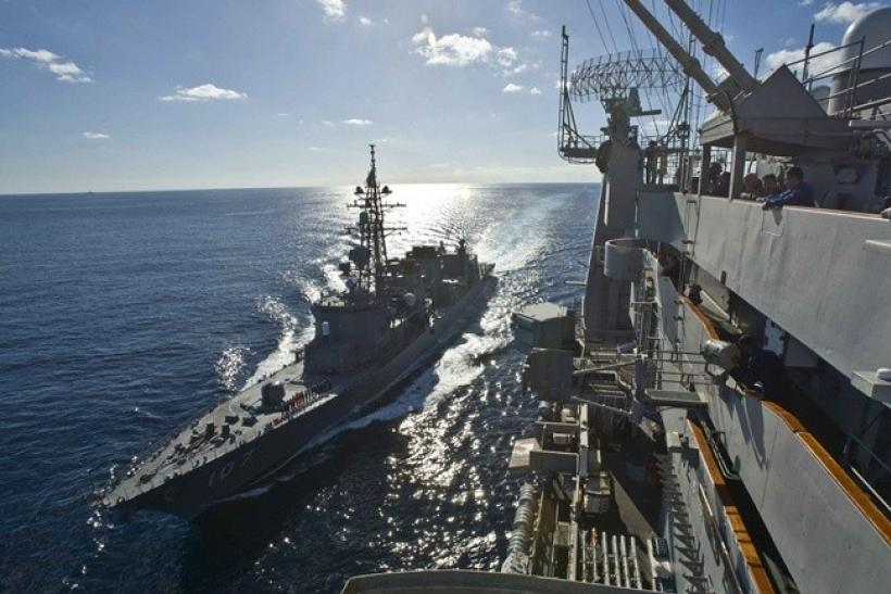 Japan Maritime Self Defence Force destroyer Ikazuchi (L) sails alongside the USS George Washington during their military maneuvers known as Keen Sword 2011, in the Pacific Ocean December 5, 2010.