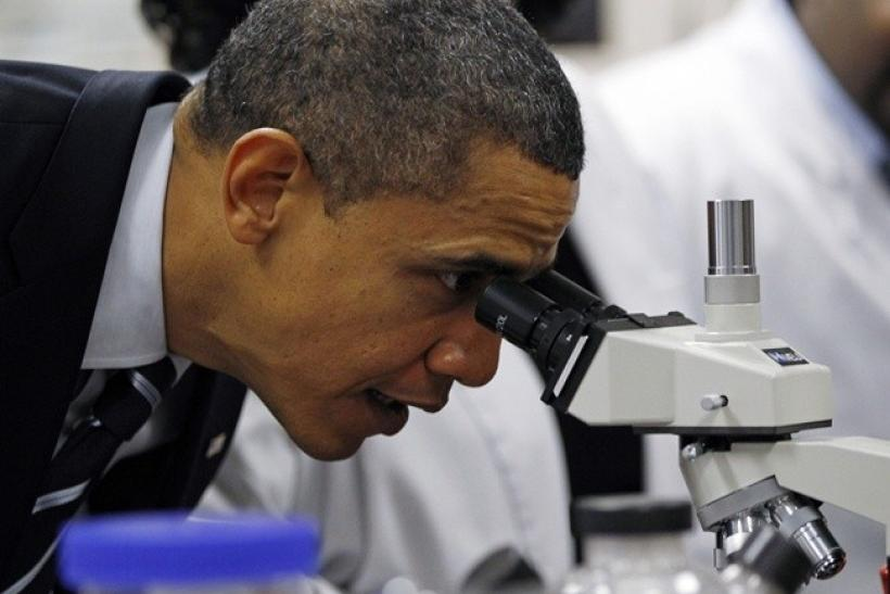 U.S. President Barack Obama looks through a microscope as he tours Bio Tech Facilities at Forsyth Technical Community College in Winston-Salem, North Carolina, December 6, 2010.