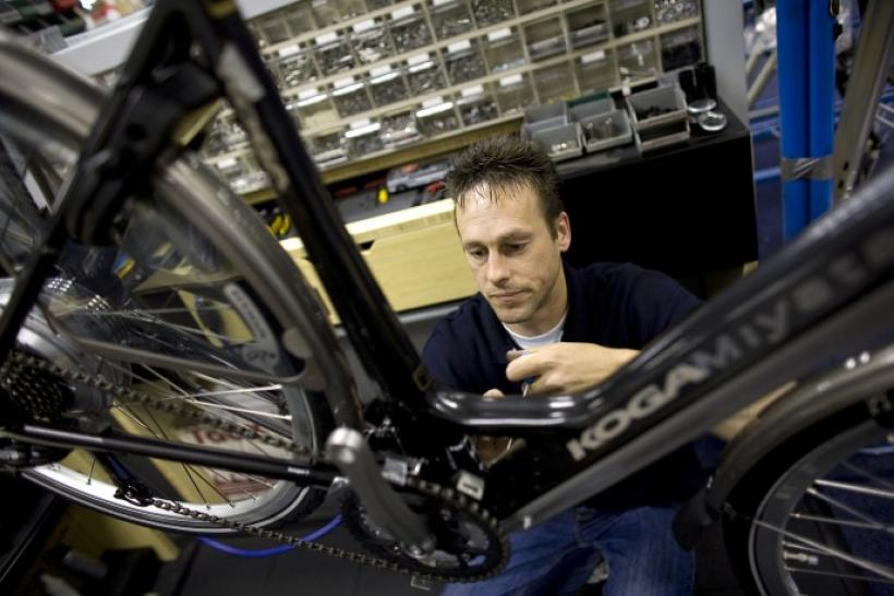 A worker assembles a Koga Miyata bicycle at the company's factory in the Dutch northern town of Heerenveen