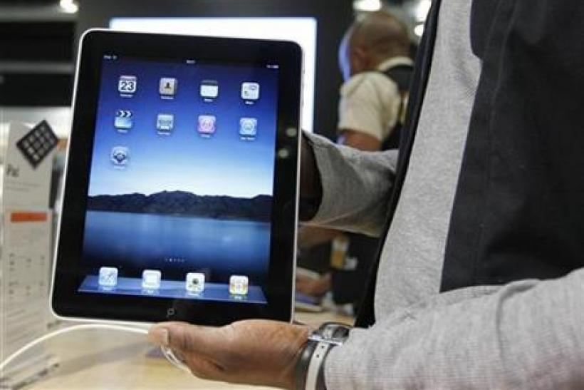 Salesman displays an Apple iPad during its launch in Brussels