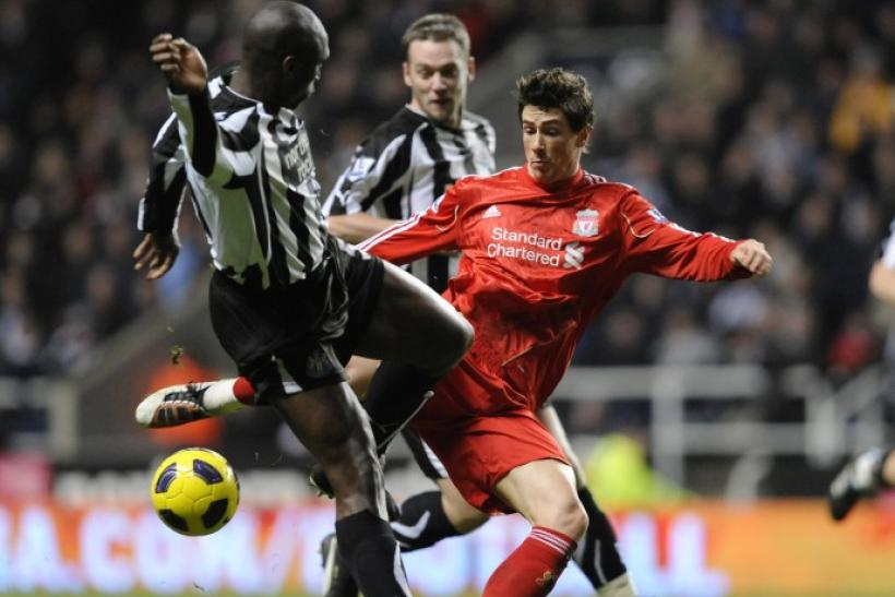 Newcastle United's Campbell challenges Liverpool's Torres during their English Premier League soccer match in Newcastle.