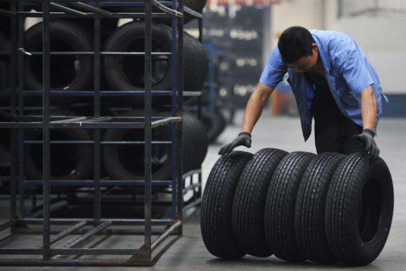 An employee moves tires at a tire factory in Hefei.