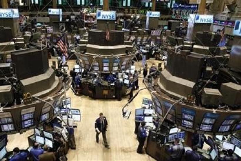 Traders work on the floor of the New York Stock Exchange,