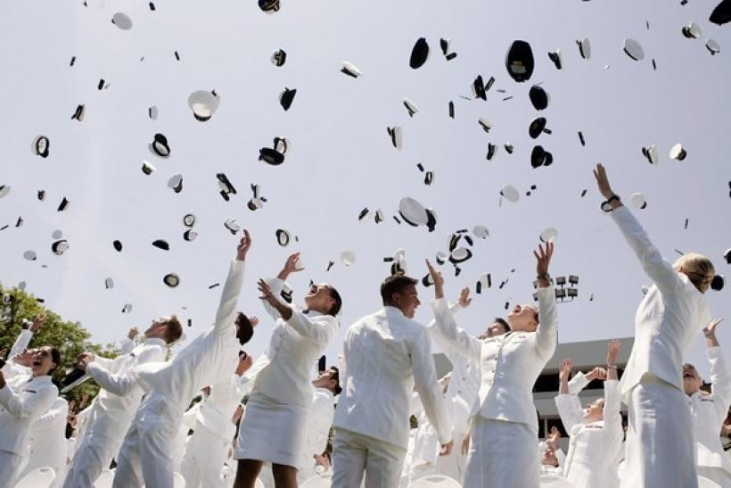 U.S. Coast Guard Academy graduates celebrate after a ceremony in New London, Connecticut, May 23, 2007.
