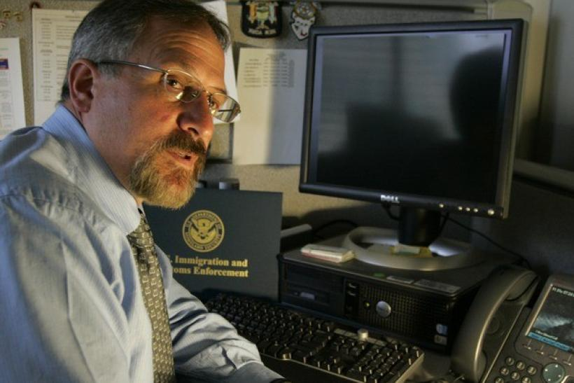 U.S. Immigration and Customs Enforcement special agent Don Daufenbach is interviewed in his Cyber Crimes Center's office in Fairfax, Virginia July 24, 2009.