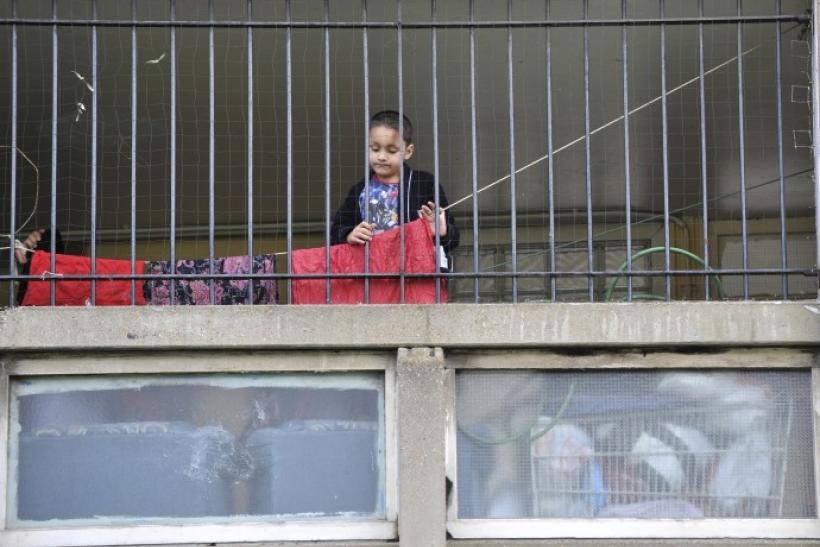 A child plays behind railings on the Robin Hood Gardens estate in Poplar in East London
