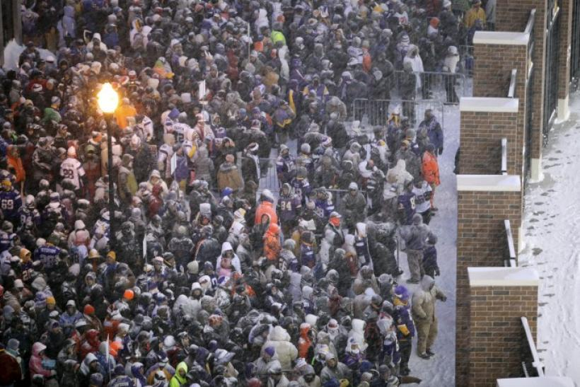 Fans wait for gates to open before start of the Vikings' outdoor NFC, NFL football game against the Bears in Minneapolis