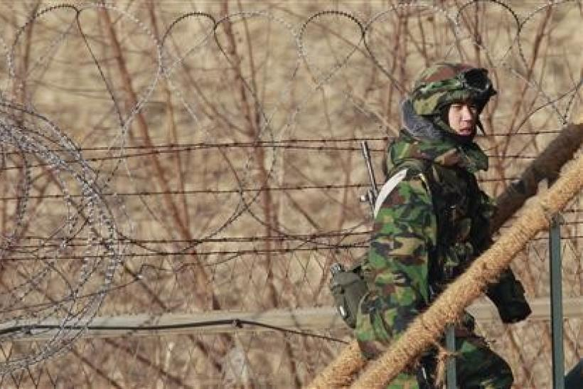 A South Korean Army soldier walks up steps of a guard post near the demilitarised zone separating the two Koreas.