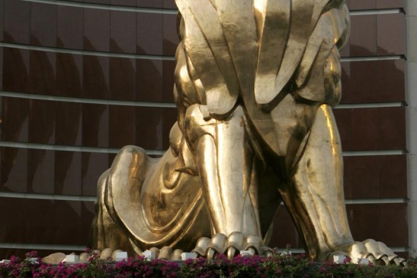 People walk past a giant lion sculpture at the MGM Grand Macau hotel resort in Macau
