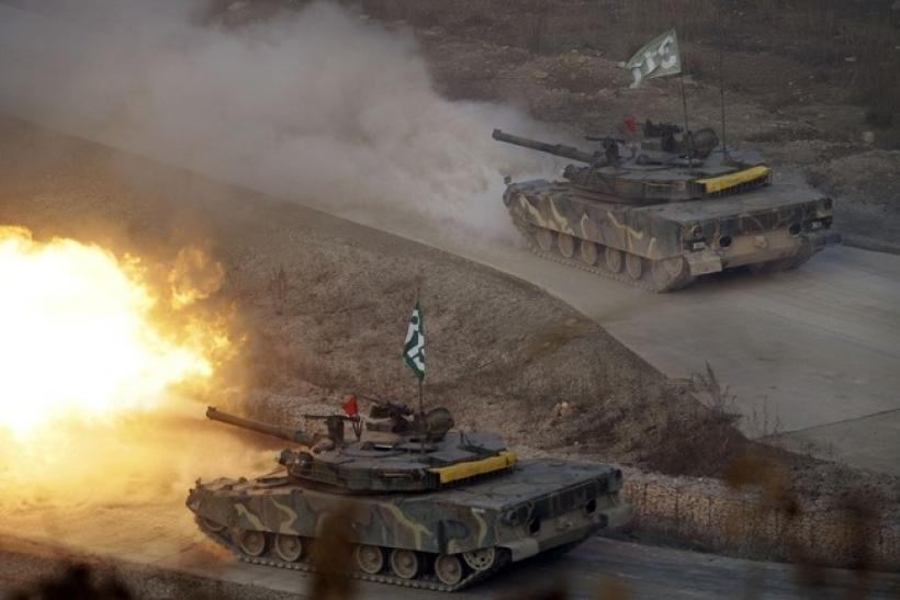 South Korea K-1 tanks fire live rounds during air and ground military exercises on the Seungjin Fire Training Field, in mountainous Pocheon December 23, 2010.
