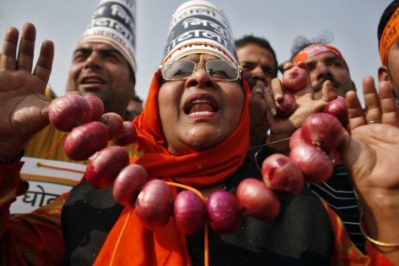 An activist from India's main opposition BJP wearing an onion garland shouts slogans during a protest in New Delhi