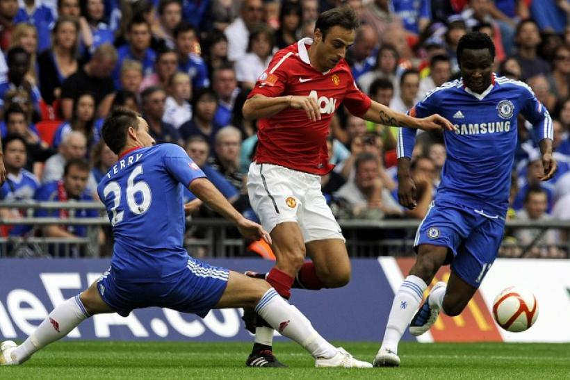 Chelsea's Terry and Mikel challenge Manchester United's Berbatov during their English Community Shield soccer match at Wembley Stadium in London.
