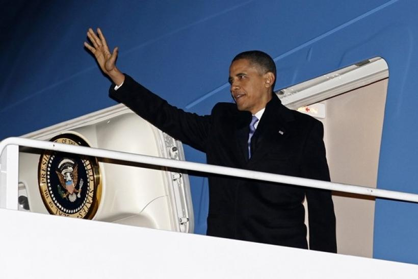U.S. President Barack Obama boards Air Force One enroute to Hawaii for vacation December 22, 2010.