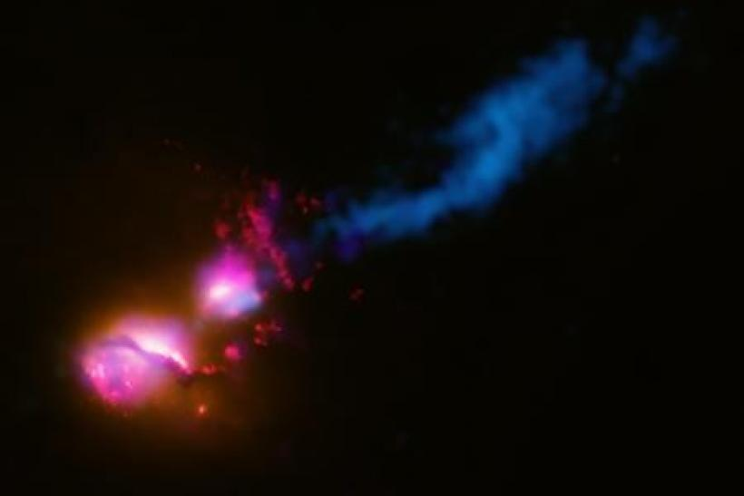 This composite image shows the jet from a black hole at the center of a galaxy