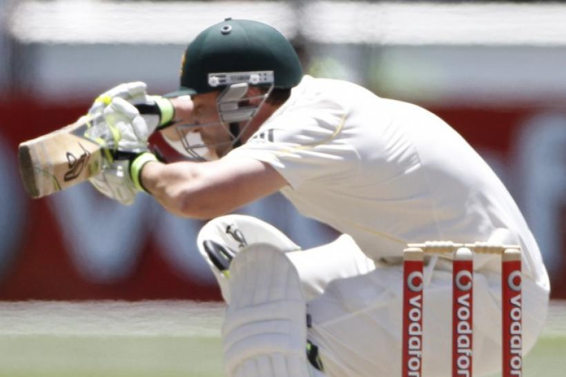 Australia's Hughes ducks under a bouncer during the third day of the fourth Ashes cricket test against England at the Melbourne Cricket Ground.