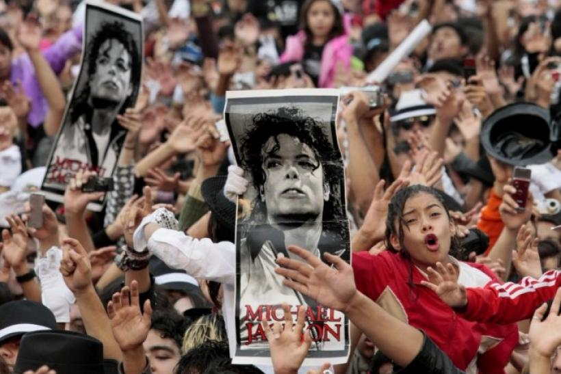 Michael Jackson fans hold up his poster in Mexico City August 29, 2009