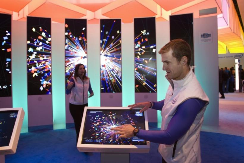 """An intel demonstrator creates digital art at Intel's """"Visibly Smart Experience"""" during the Consumer Electronics Show in Las Vegas"""